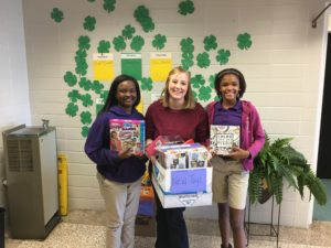 President and Vice President of 4-H club present toy donation with 4-H Club Sponsor, Carina Phillips